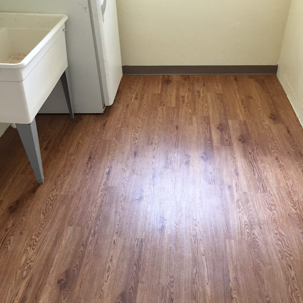 Laundry Room With New Laminate Flooring Installed
